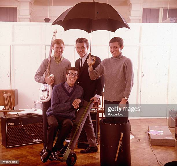 English group The Shadows posed together backstage in England in 1963 From left to right Bass guitarist Brian 'Licorice' Locking guitarist Hank...