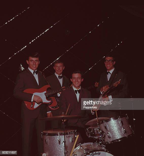English group The Shadows posed together onstage in England in 1963 From left to right Guitarist Bruce Welch bass guitarist Brian 'Licorice' Locking...