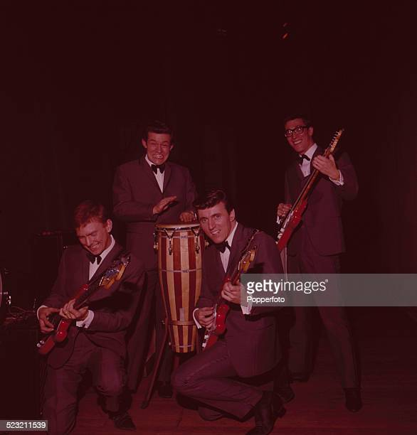 English group The Shadows posed together onstage in England in 1963 From left to right Bass guitarist Brian 'Licorice' Locking drummer Brian Bennett...