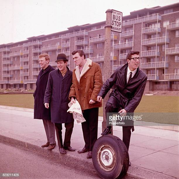 English group The Shadows posed together standing at a bus stop on a housing estate in Kent England in 1963 From left to right Brian 'Licorice'...