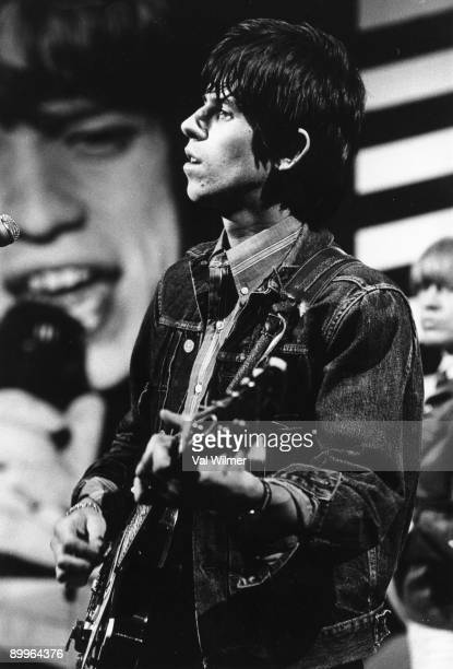 English guitarist Keith Richards in concert with The Rolling Stones performs live on stage on the TV show 'Ready Steady Go' circa 1965 Brian Jones is...