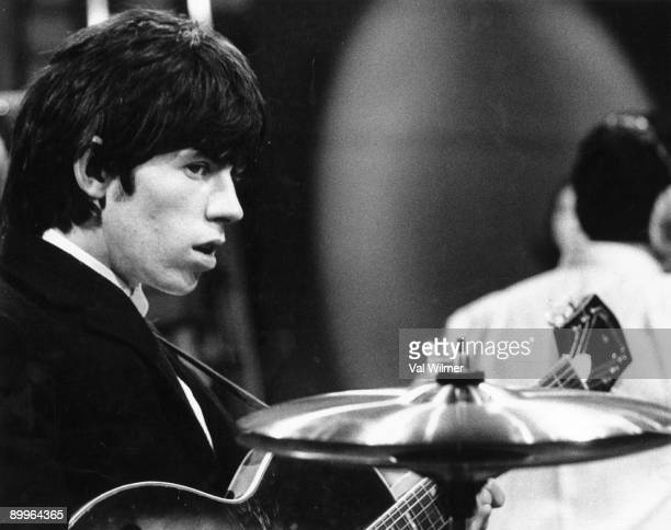 English guitarist Keith Richards of The Rolling Stonesperforms live on stage on the TV show 'Ready Steady Go' circa 1965