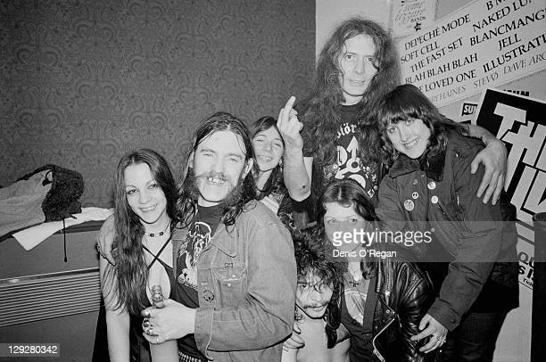 English heavy metal group Motorhead backstage with friends Leeds circa 1980 Left to right bassist and singer Lemmy drummer Phil 'Philthy Animal'...