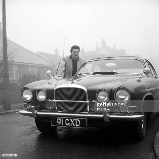 English heavyweight boxer Brian London with his Jaguar Mark X formerly owned by Warwick Films and used by Sean Connery in James Bond 007