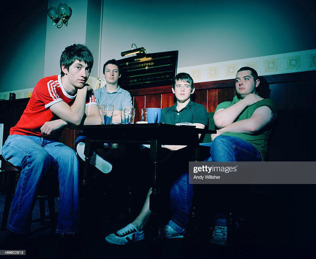 English indie rock band Arctic Monkeys in a pub, 2006. Left to right: singer Alex Turner, drummer Matt Helders, guitarist Jamie Cook and bassist Andy Nicholson.