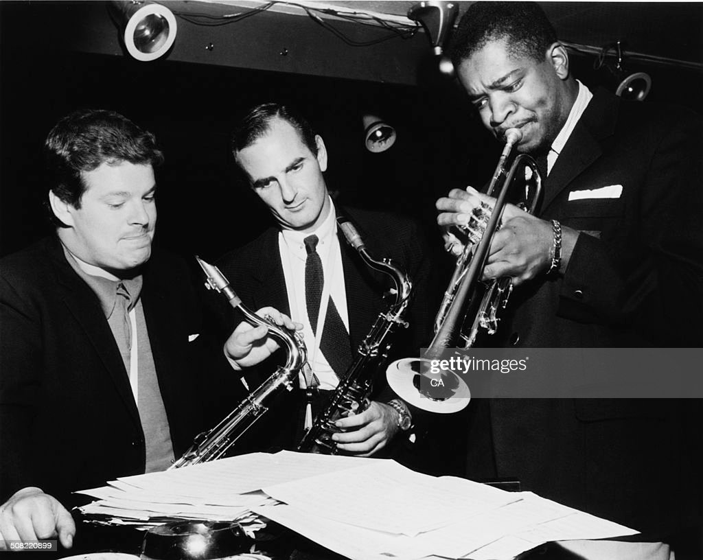 English jazz multi-instrumentalist, Edward Brian 'Tubby' Hayes (1935 - 1973) (left), English jazz tenor saxophonist and jazz club owner, Ronnie Scott (1927 - 1996) (centre), and American jazz and rhythm and blues trumpeter, <a gi-track='captionPersonalityLinkClicked' href=/galleries/search?phrase=Donald+Byrd&family=editorial&specificpeople=1551105 ng-click='$event.stopPropagation()'>Donald Byrd</a> (1932 - 2013) during rehearsal, circa 1965.