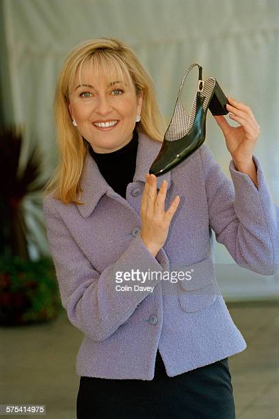English journalist and television presenter Fiona Phillips holding a woman's shoe UK 29th October 1996