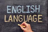 English language. Hand drawing English Language on blackboard. Close up.