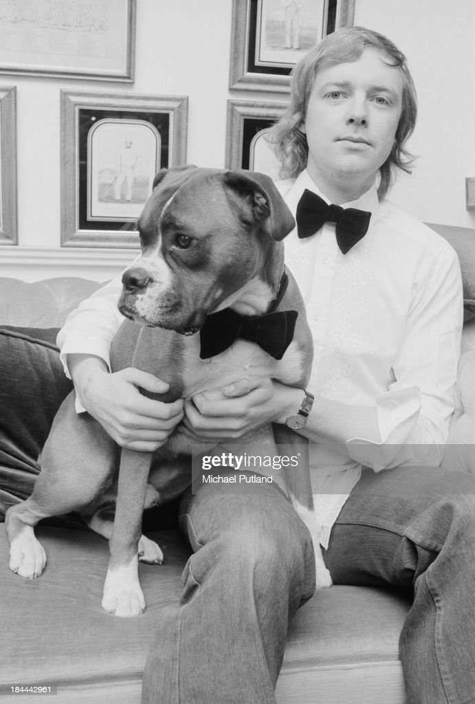 English lyricist Tim Rice and his boxer dog both wearing bow ties 12th October 1973