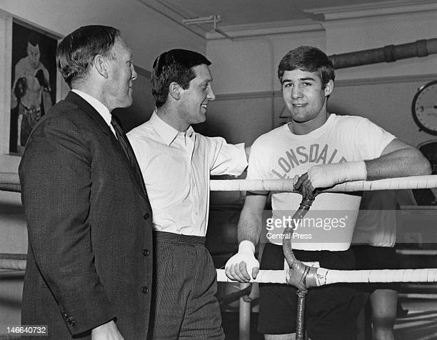 English middleweight boxer Mark Rowe with his new trainer Charlie Tucker and manager Arthur Boggis during a training session at the Thomas A Becket...