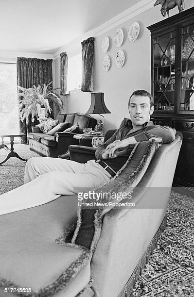 English Middleweight champion boxer Alan Minter pictured sitting on a couch on 2nd September 1980