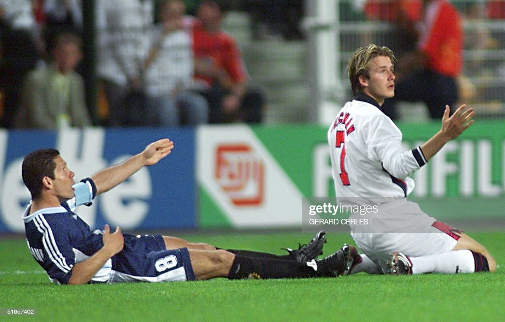 English midfielder David Beckham (R) and Argentinan captain Diego Simeone (L) react after foul play by Beckham during the 1998 Soccer World Cup second round match between Argentina and England, 30 June at Geoffroy Guichard stadium in Saint-Etienne, central France. Beckham was sent off the pitch after getting a red card by Danish referee Kim Milton Nielsen.
