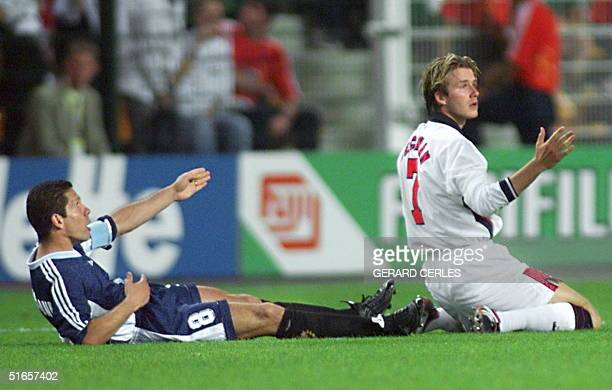 English midfielder David Beckham and Argentinan captain Diego Simeone react after foul play by Beckham during the 1998 Soccer World Cup second round...