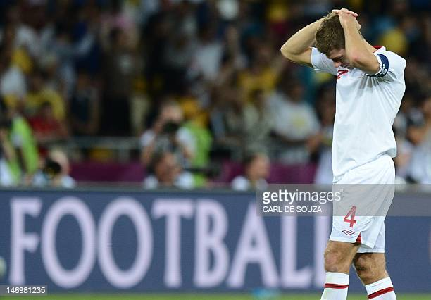 English midfielder Steven Gerrard reacts after being beatin in a penalty shoot out during the Euro 2012 football championships quarterfinal match...