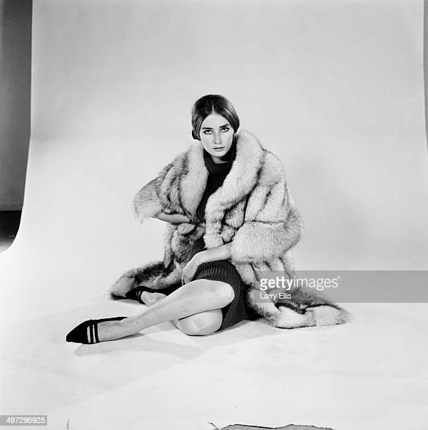 English model and actress Tania Mallet wearing a fur coat UK 19th November 1964