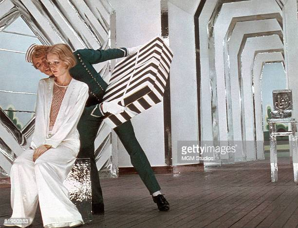English model and actress Twiggy as Polly Browne with Christopher Gable as Tony Brockhurst in a scene from the fim version of Sandy Wilson's musical...