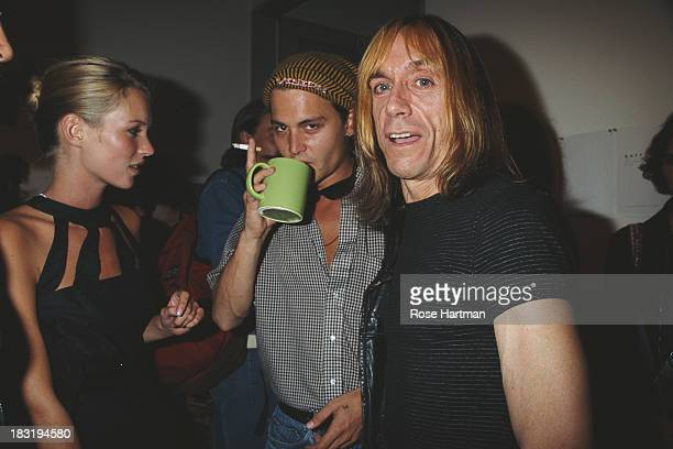 English model Kate Moss American actor and film producer Johnny Depp and American singersongwriter Iggy Pop at the 'Kate The Kate Moss Book' party...