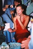 English model Kate Moss photographed backstage at fashion show in the early 1990's