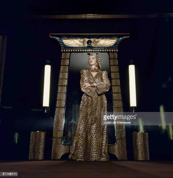 English model Twiggy models a leopardskin robe against an ancient Egyptianstyle backdrop at Biba's Kensington store 1971