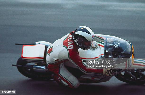 English motorcycle racer Phil Read competes on his Suzuki RG500cc racing bike during the Gauloises Powerbike International race meeting at Brands...