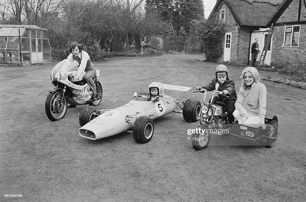 English motorcycle road racer Phil Read with his sons Michael and Graham and their Christmas present, a £395 JoMoRo miniature children's racing car, the Mighty Microbe, UK, 22nd December 1971.