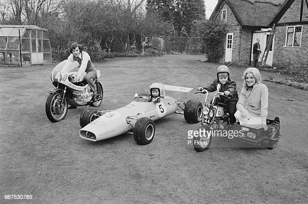 English motorcycle road racer Phil Read with his sons Michael and Graham and their Christmas present a £395 JoMoRo miniature children's racing car...
