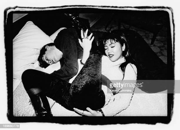 English musician Alex James bass player for alternative rock band Blur with an unknown woman in Tokyo Japan November 1992