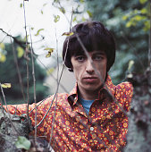 English musician and bass guitarist with The Rolling Stones Bill Wyman posed wearing a floral pattern shirt in 1967