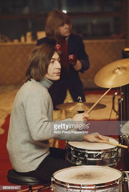 English musician and drummer with Rolling Stones Charlie Watts pictured playing drums during rehearsals for the Rolling Stones Rock and Roll Circus...
