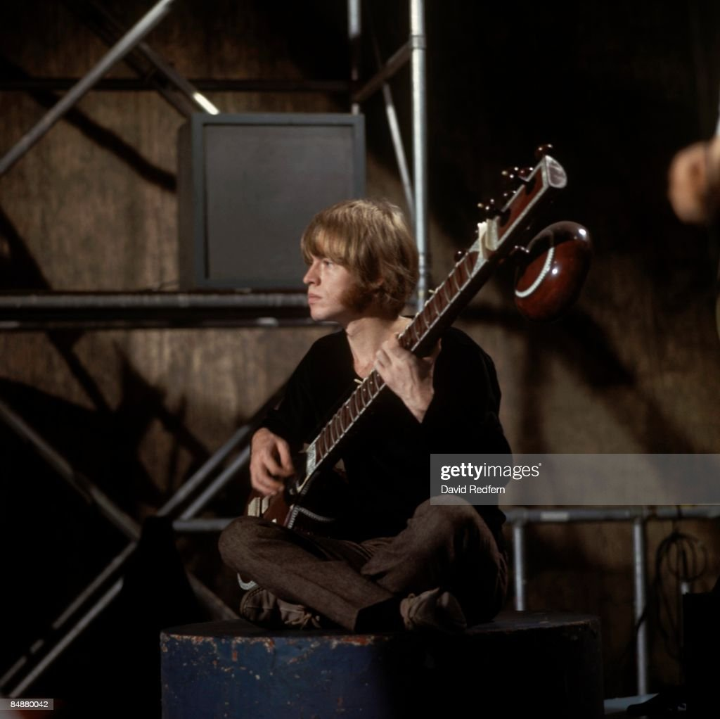 GO Photo of ROLLING STONES and Brian JONES of Rolling Stones performing 'Paint It Black' on 'Ready Steady Go' at Wembley Studios playing sitar