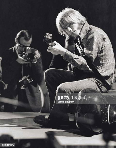 Photo of Brian JONES of Rolling Stones performing on TV Show playing guitar with photographer David Redfern Premium Collection