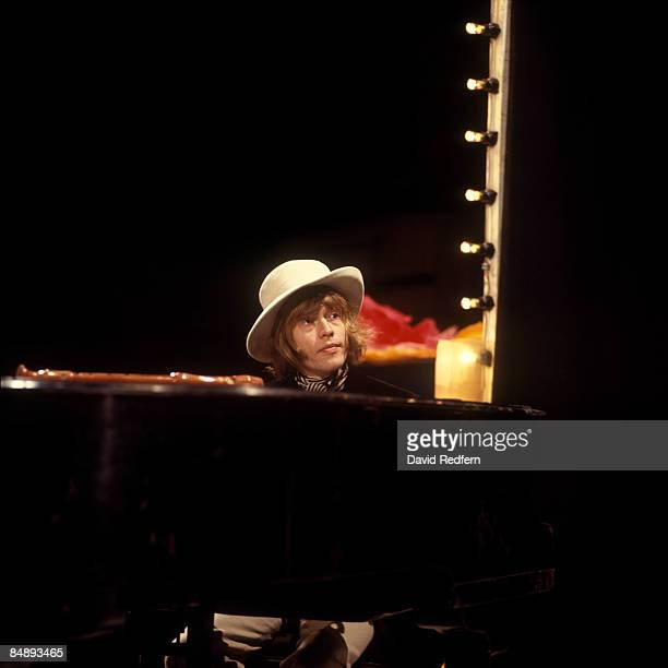 POPS Photo of Brian JONES and ROLLING STONES of Rolling Stones performing 'Let's Spend The Night Together' playing piano on UK TV Show