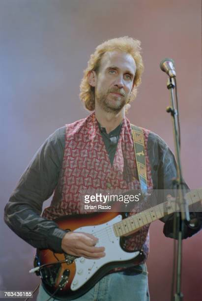 English musician and guitarist Mike Rutherford of Genesis and Mike and the Mechanics performs live on stage playing a Fender Stratocaster guitar at...