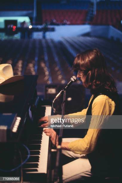English musician and keyboard player Roger Hodgson performs at a piano on stage with Supertramp during a soundcheck on tour in the United States in...