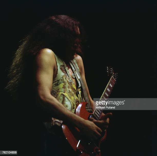 English musician and lead guitarist with rock group Uriah Heep Mick Box performs live on stage with the band playing a Gibson SG guitar circa 1975