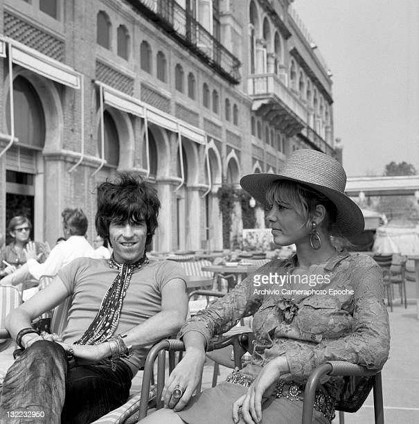 English musician Keith Richards with Anita Pallenberg sitting outside the Excelsior Hotel Lido Venice 1967