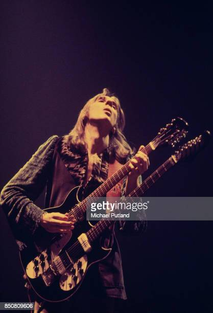 English musician Mike Rutherford of rock group Genesis performs on stage April 1976