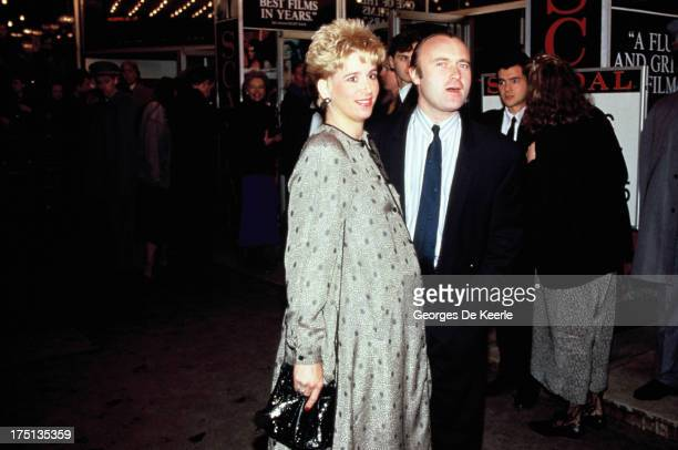 English musician Phil Collins and his pregnant wife Jill Tavelman attend the premier of 'Scandal' on March 3 1989 in London England