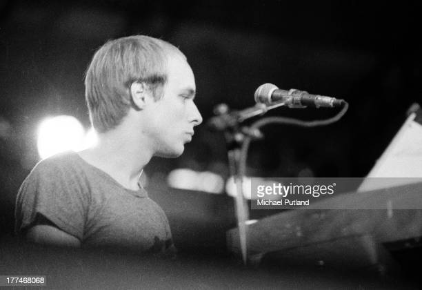 English musician producer and composer Brian Eno performs on stage with experimental rock group 801 at the Reading Festival 28th August 1976