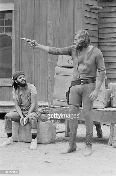 English musician Ringo Starr former drummer with The Beatles with actor Mal Evans on the set of the spaghetti western 'Blindman' being filmed in...