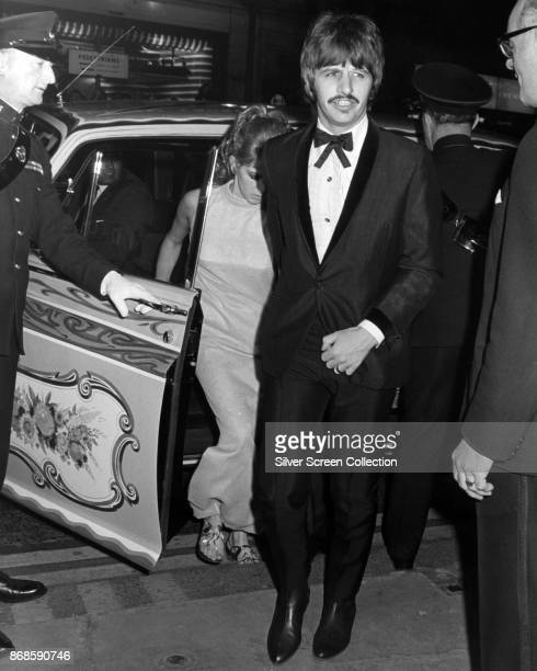English musician Ringo Starr of the Beatles and his wife Maureen Starkey step out of a car as they arrive at an unspecified event late 1960s