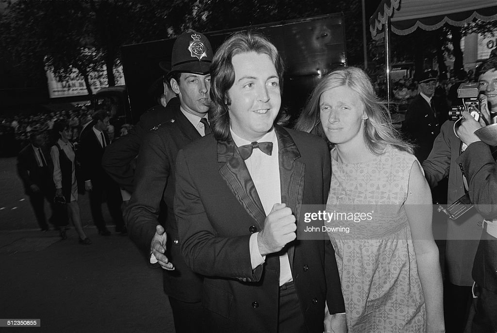 English musician singer and songwriter Paul McCartney and his wife American musician and photographer Linda McCartney arrive at the film premiere of...