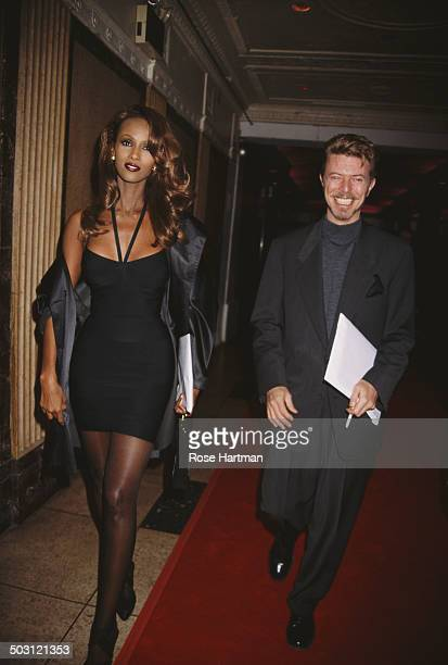 English musician singersongwriter and actor David Bowie and his wife Somali fashion model Iman leaving a theatre on Broadway New York City circa 1996