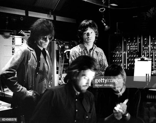 English musicians Keith Richards and Mick Jagger of the Rolling Stones along with producers Jimmy Miller and Glyns Johns work on the mixing of their...