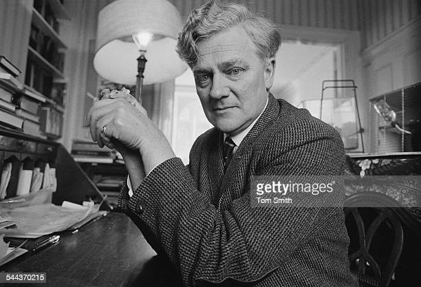 English novelist Richard Adams holding a pet mouse 3rd March 1974