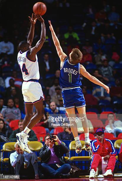 J English of the Washington Bullets goes up to shoot over Brooks of the Dallas Mavericks during an NBA basketball game circa 1990 at the Capital...