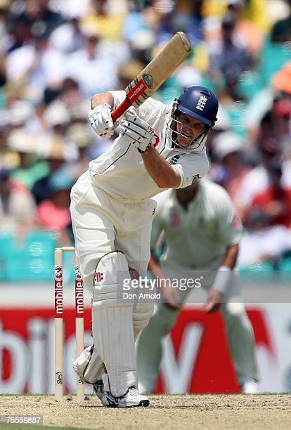 English opener Andrew Strauss struggles to negotiate a rising delivery from Glen McGrath in the opening session of the fifth test between Australia...