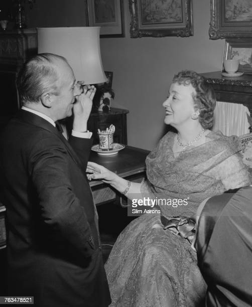 English photographer Cecil Beaton and Millicent Hearst widow of media mogul William Randolph Hearst at Gilbert and Kitty Miller's New Year's Eve...
