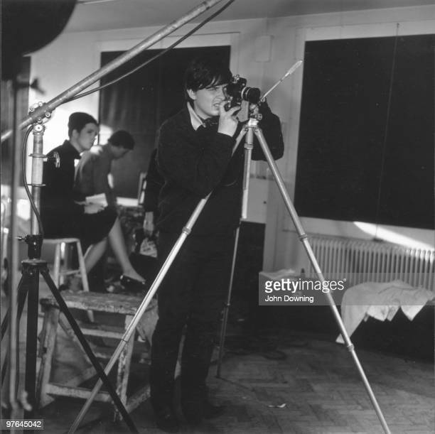 English photographer David Bailey at work in the Vogue studios