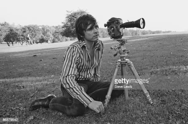 English photographer David Bailey sets up an outdoors shot in a London park circa 1967